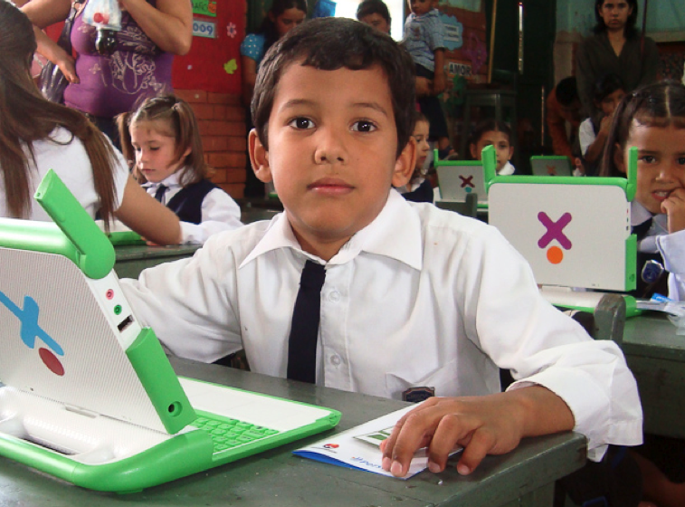 "Technology ""to create educational opportunities for the world's poorest children"" – with infographic of OLPC's evolution"